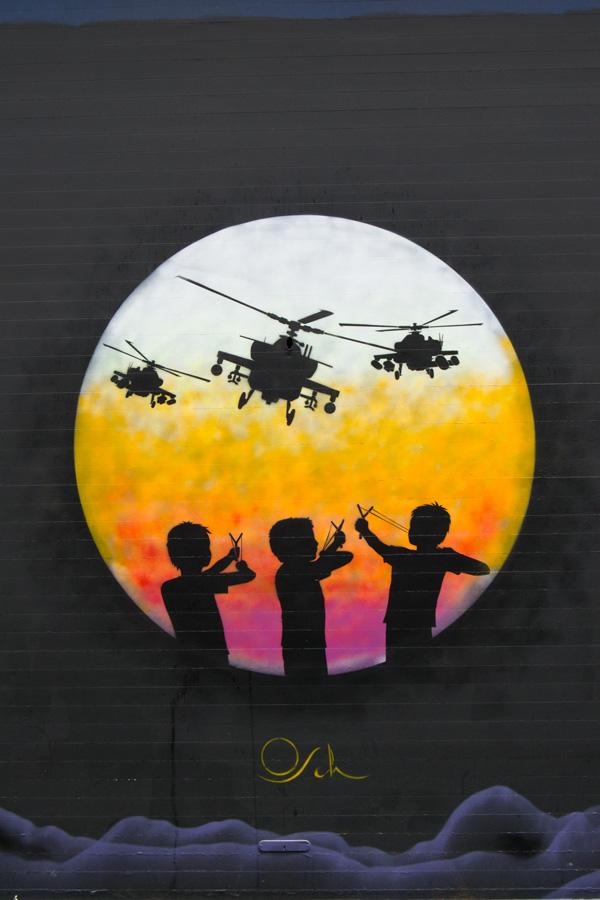 Osch aka Otto Schade #Shoreditch street art slingshots vs helicopters