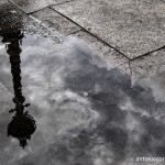 A lamppost reflected in the puddle
