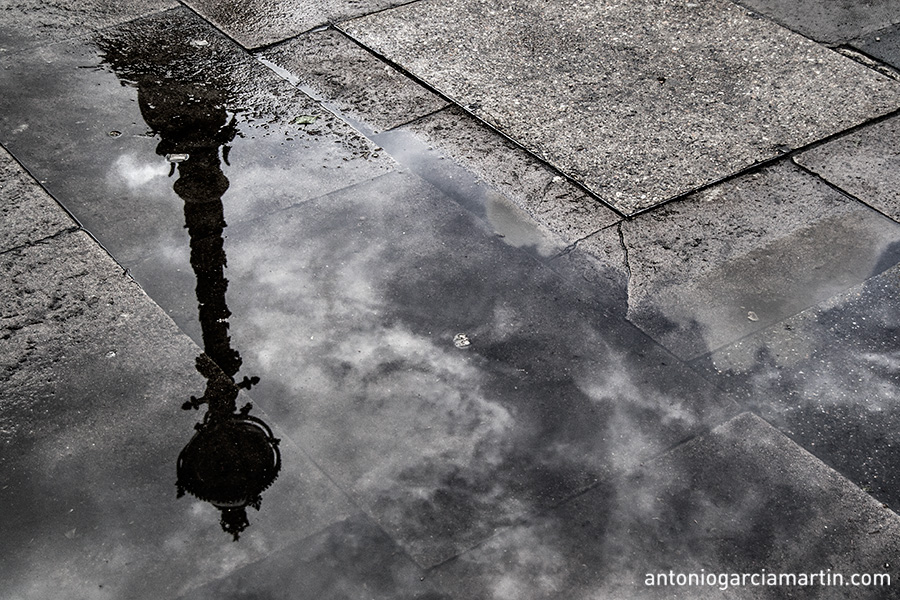 The reflection of a lamppost in Southbank in the Thames Riverside at London