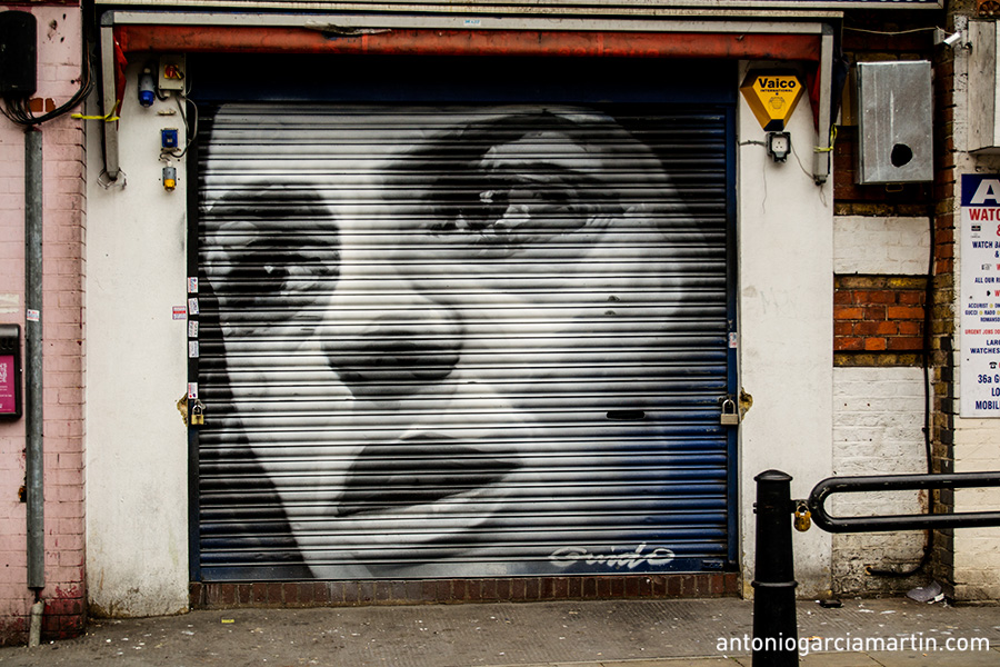 A woman portrait. Street art by Guido Van Helden at Shoreditch, London.